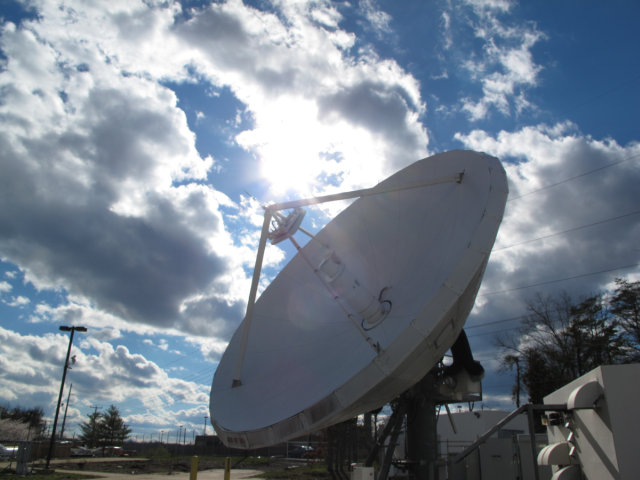 Large satellite dish, with a beautiful sky background.