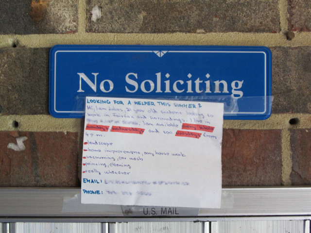 A sign says No Soliciting with a note attached to it that is soliciting.