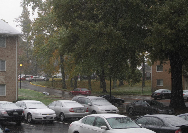 Snow falling in my apartment parking lot.  In October 2011.