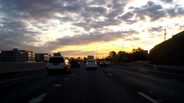 Sunrise as seen from a car, driving on the I-495 DC Beltway.
