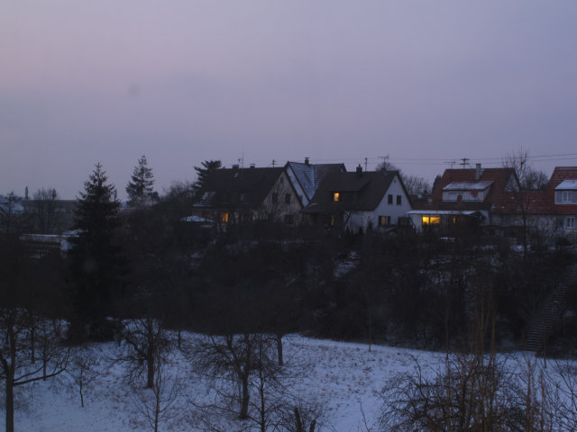 A home at twilight, in the snow, in Stuttgart, Germany