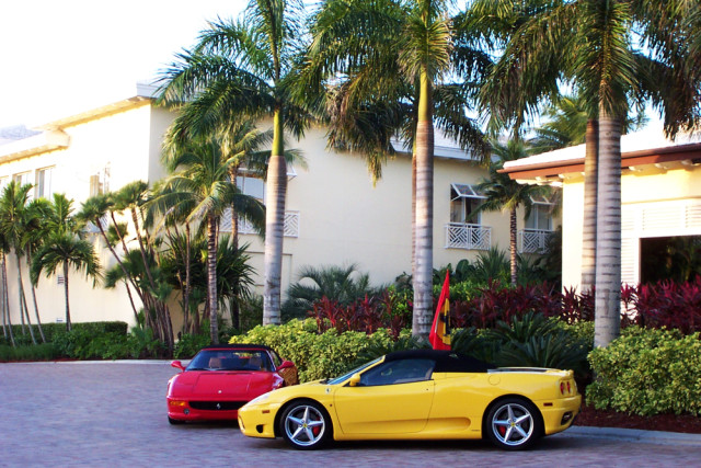 Yellow and red Ferraris parked outside of a hotel in Florida.