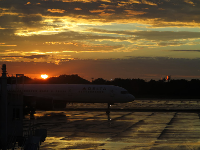 Sunset, tarmac, plane, Tampa airport.