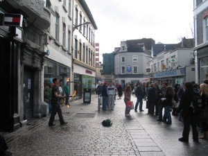 A guy juggles torches in Galway.