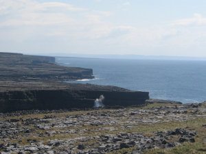 Waves, cliffs, at Dun Aengus.