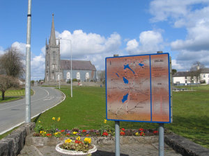 Lawn and church and sign at Mullingar.